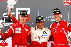 Daniel Morad celebrates victory on the podium with Mirko Bortolotti and Alexander Rossi