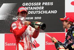 Podium: race winner Fernando Alonso, Scuderia Ferrari, third place Sebastian Vettel, Red Bull Racing