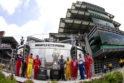 The past winners at Indianapolis Motor Speedway take a photo