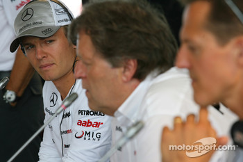 Nico Rosberg, Norbert Haug and Michael Schumacher