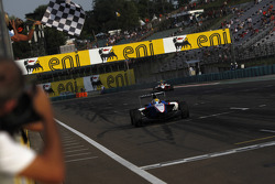 Nico Muller celebrates victory as he takes the checkered flag in front of Esteban Gutierrez