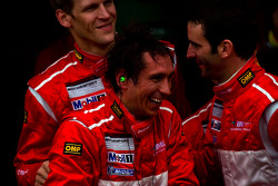 Race winners Romain Dumas, Jörg Bergmeister, Martin Ragginger and Wolf Henzler celebrate