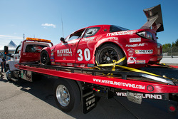 The crashed #30 Racers Edge Motorsports Mazda RX-8