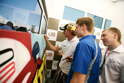 Renger Van Der Zande with Josef Newgarden and Dean Smith signing some art work