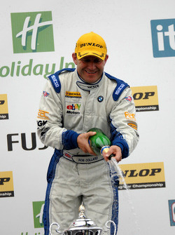 Rob Collard sprays champagne