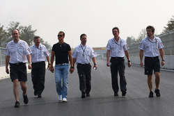 Michael Schumacher, Mercedes GP with Ross Brawn Team Principal, Mercedes GP and Andrew Shovlin, Mercedes GP, Senior Race Engineer to Michael Schumacher walking the track