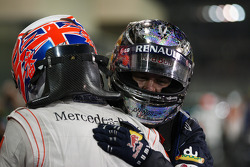 Race winner and 2010 Formula One World Champion Sebastian Vettel, Red Bull Racing, celebrates with Jenson Button, McLaren Mercedes