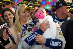 Championship victory lane: NASCAR Sprint Cup Series 2010 champion Jimmie Johnson, Hendrick Motorsports Chevrolet celebrates with wife Chandra and daughter Genevieve Marie