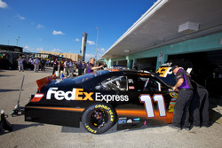 Joe Gibbs Racing Toyota team members prepare the car of Denny Hamlin