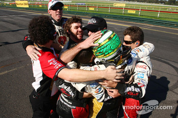 James Courtney celebrates with his team mates