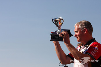 Adrian Burgess takes the trophy for the winning team