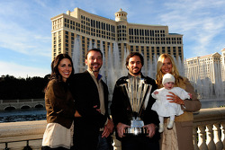 Five-time NASCAR Sprint Cup Series Champion Jimmie Johnson, his daughter Genevieve Marie, his wife Chandra, crew chief Chad Knaus and Lisa Rockelmann pose outside the Bellagio Hotel and Casino Resort