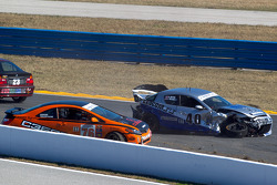 #40 Berg Racing Mazda RX-8: Robert Mitten, John Weisberg and #76 Compass360 Racing Honda Civic SI: Dan Rogers, Carlos Tesler-Mabe sit in the middle of the track