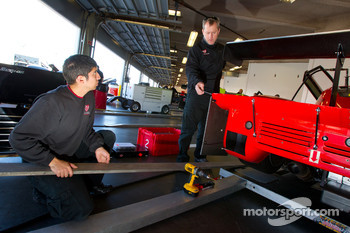 Flying Lizard Motorsports team members at work