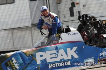 T. J.. Zizzo being towed to the scales in his Peak Performnce Top Fuel Dragster