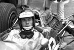 Jim Clark in the cockpit of his Lotus 49 with the Ford DFV V8 engine behind him; Clark won the 1967 Grand Prix of Holland at Zandvoort with this engine in its debut race