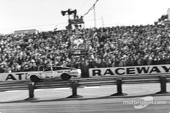 Cale Yarborough takes the checkered flag in his third consecutive victory