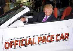 Donald Trump settles into his new ride as the 2011 Indianapolis 500 Chevrolet Camaro SS Convertible Pace Car driver for the 100th Anniversary of the Indianapolis 500