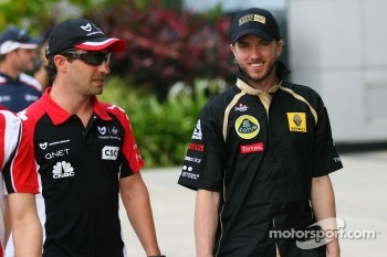 Timo Glock, Marussia Virgin Racing with Nick Heidfeld, Lotus Renault GP