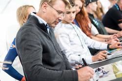 Mika Hakkinen signs autographs for the fans