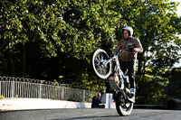 Road racing Photos - Dougie Lampkin with Wheelie around Isle of Man
