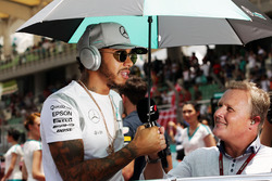 Lewis Hamilton, Mercedes AMG F1 with Johnny Herbert, Sky Sports F1 Presenter on the drivers parade