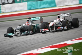 Michael Schumacher, Mercedes GP F1 Team and Kamui Kobayashi, Sauber F1 Team
