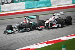 Michael Schumacher, Mercedes GP F1 Team and Kamui Kobayashi, Sauber F1 Team