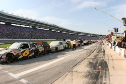 NASCAR Sprint Cup cars sit on pit lane before the SamSung  Mobil 500
