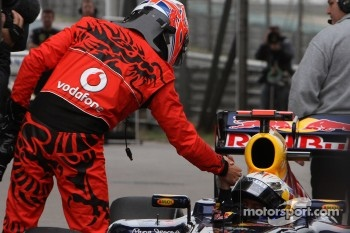 Jenson Button, McLaren Mercedes and pole winner Sebastian Vettel, Red Bull Racing