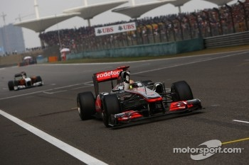 Lewis Hamilton, McLaren Mercedes takes the checkered flag