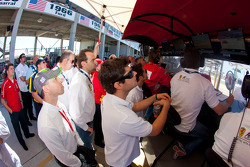 Pierre Kaffer and AF Corse team members watch GT qualifying