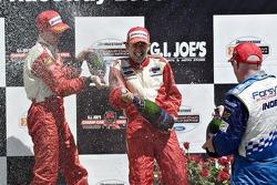 Cristiano da Matta, Sébastien Bourdais and Paul Tracy on the victory podium