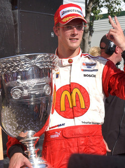 Race winner and Champ Car World Series 2005 champion Sébastien Bourdais celebrates poses with the Vanderbilt Cup