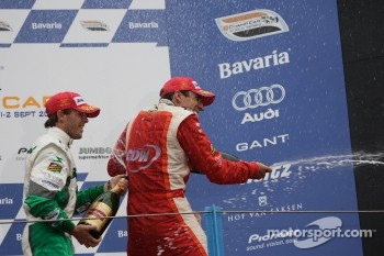 Podium: champagne for Justin Wilson and Jan Heylen