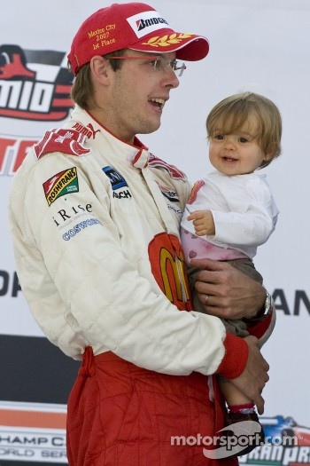 Podium: race winner Sbastien Bourdais celebrates with daughter Emma