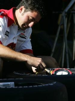 Newman/Haas/Lanigan Racing crew member prepares wheels