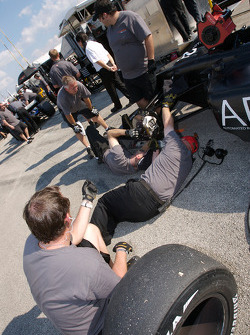 Conquest Racing team members work on the car of Franck Perera
