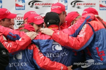 Race winner Dario Franchitti celebrates with his team