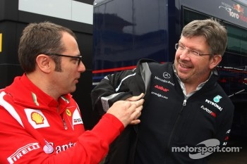 Stefano Domenicali, Scuderia Ferrari Sporting Director and Ross Brawn, Mercedes GP, Technical Director