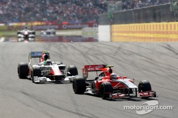 Jerome d'Ambrosio, Marussia Virgin Racing leads Vitantonio Liuzzi, Hispania Racing Team, HRT