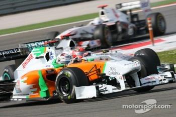 Adrian Sutil, Force India F1 Team and Michael Schumacher, Mercedes GP F1 Team