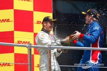Stefano Coletti celebrates his victory on the podium with Sam Bird