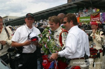 Indianapolis 500 Dan Wheldon is escorted to the pace car