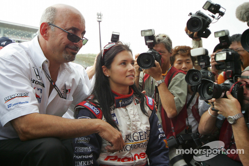 Danica Patrick celebrates front row qualifying with Bobby Rahal