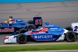 Dario Franchitti dives under Alex Barron