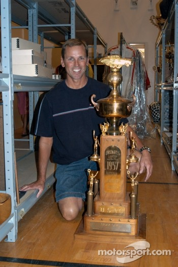 Johnny Unser with father Jerry Jr.'s 1957 USAC Stock Car Championship trophy