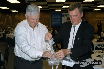 Wyatt Swaim hands corsage to Johnny Rutherford