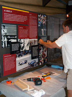 Installation of Al Unser, Jr. exhibit in Indy 500 room