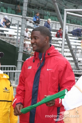 World record holder in the 100m, Justin Gatlin prepares to throw the green flag for practice